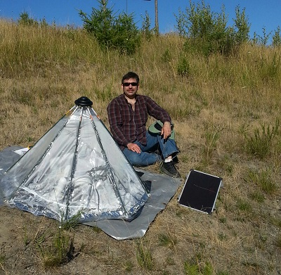 Picture of joe with cone shaped flexible A2Wh unit at Johnson farm test site 2013